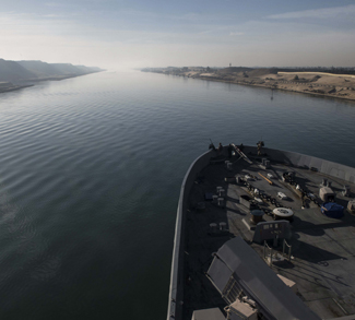 171212-N-BK384-039 U.S. 5TH FLEET AREA OF OPERATIONS (Dec. 12, 2017) The amphibious transport dock ship USS San Diego (LPD 22) transits the Suez Canal. San Diego, with the embarked 15th Marine Expeditionary Unit, is deployed to the U.S. 5th Fleet area of operations in support of maritime security operations to reassure allies and partners and preserve the freedom of navigation and the free flow of commerce in the region. (U.S. Navy photo by Mass Communication Specialist 3rd Class Justin A. Schoenberger/Released), http://www.navy.mil/management/photodb/photos/171212-N-BK384-039.JPG