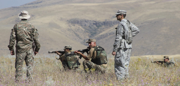A small group of Kansas Army National Guardsmen share ideas and advise soldiers with the Armenian Peacekeeping Brigade at a training site near Yerevan, Armenia, July 29, 2015. Army National Guard photo by Sgt. Zach Sheely, cc public domain, modiifed, https://www.defense.gov/observe/photo-gallery/igphoto/2001836902/